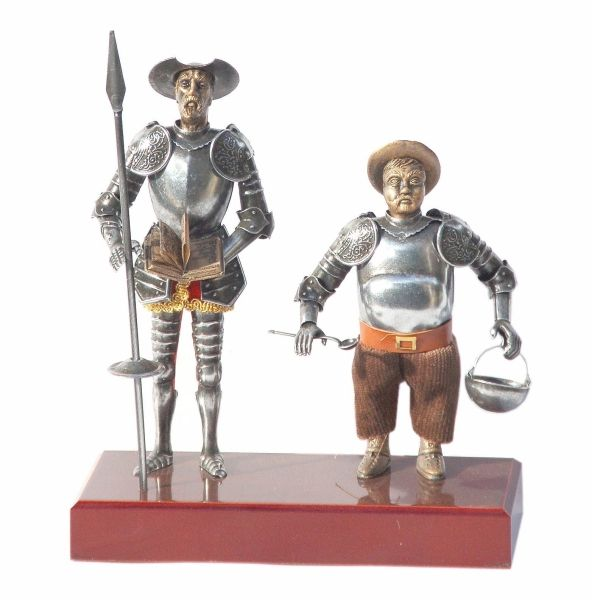 Figures Don Quixote and Sancho Panza in miniature