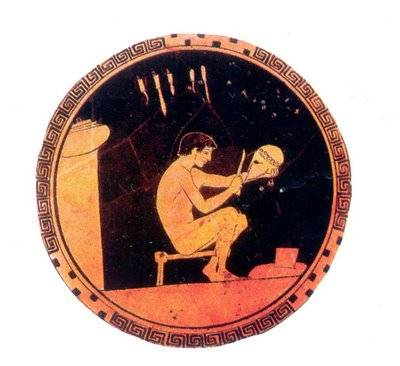 Greek pottery with craftsman making a Corinthian helmet