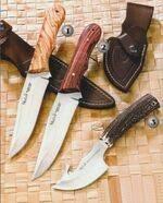 Muela pioneer and racoon knives