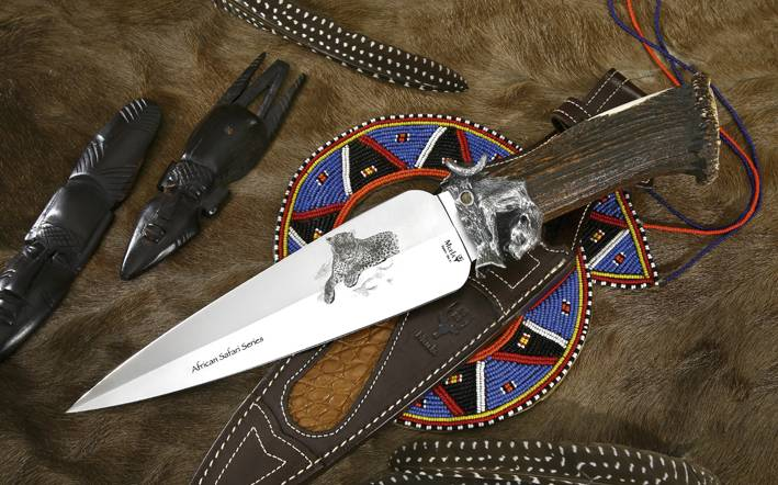 Leopard knife with antler handle and double edge